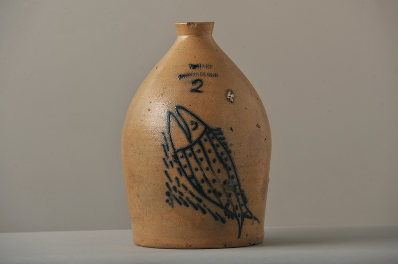 Stoneware jug with fish